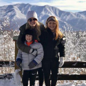 Hollie and family ski photo